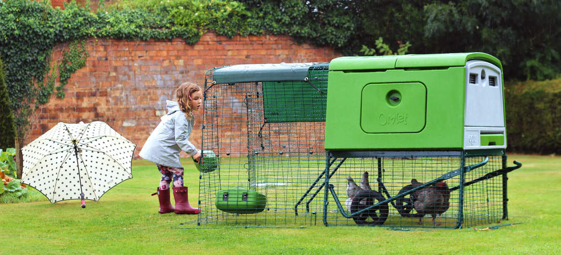 The Eglu Cube's stable style run doors make it easy to replenish your chicken's feed and water.