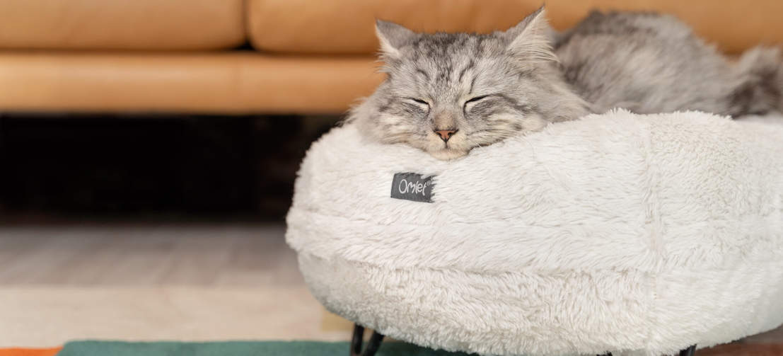 The Maya Donut is a premium cat bed with deep, donut style cushioning and customisable designer feet.