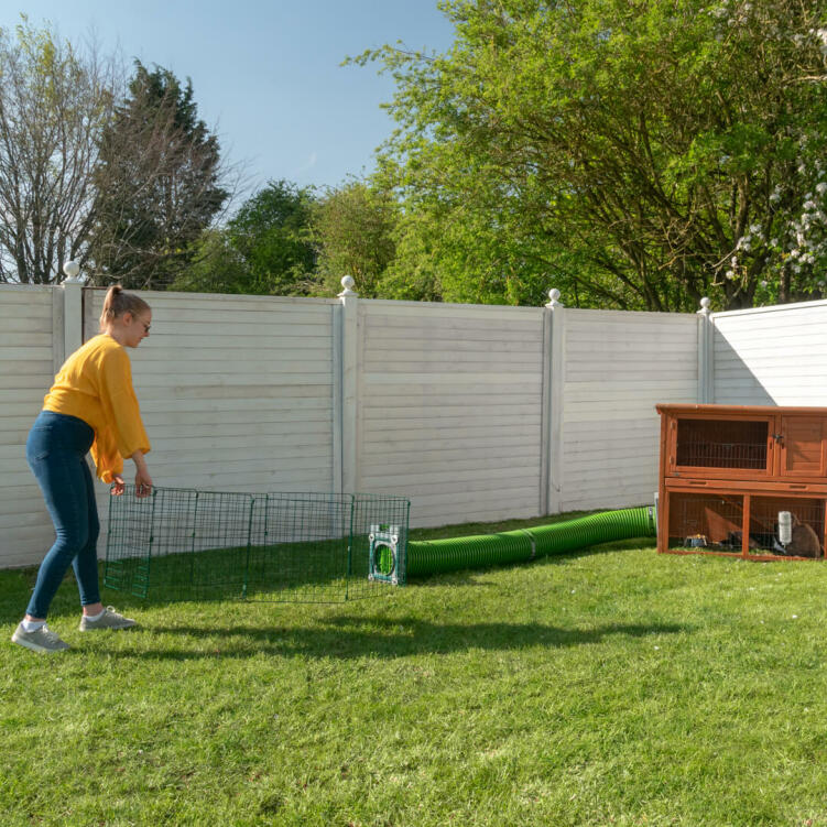 It's quick to move a Zippi rabbit playpen to a fresh spot of grass.