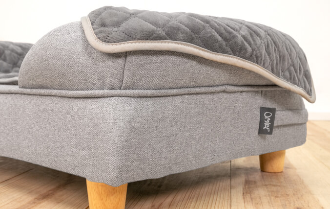 Beneath the upholstery grade fabric, the Omlet Bolster Bed offers a high performance memory foam mattress.