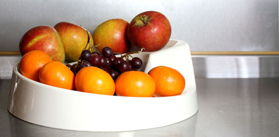 A cream Rollabowl filled with fruit in the kitchen