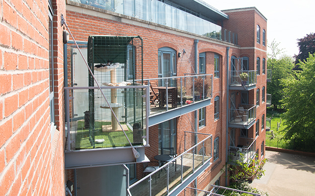 Looking across at a balcony showing how the cat balcony enclosure fits easily