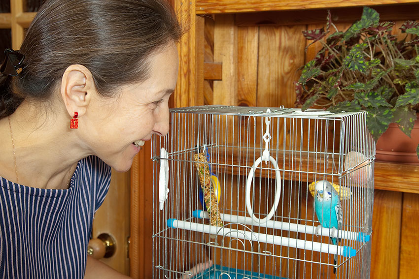 woman with budgie