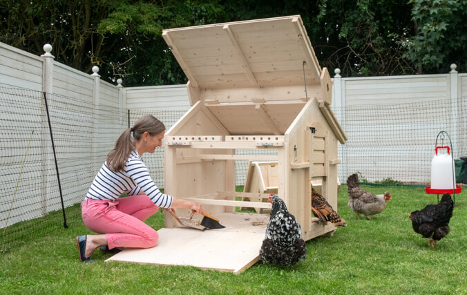 The large chicken coop has several practical features that makes it super easy to keep clean.